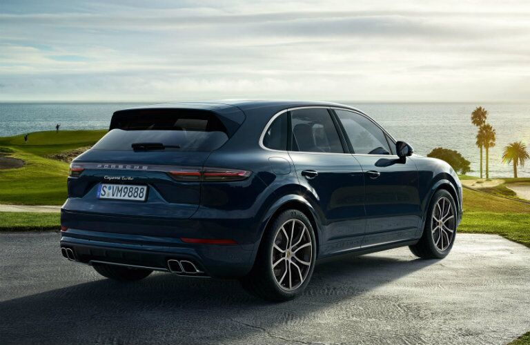 rear and side view of blue 2019 porsche cayenne