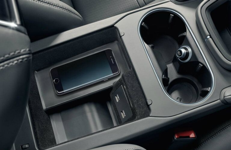 wireless charging pad and cupholders of 2019 porsche cayenne