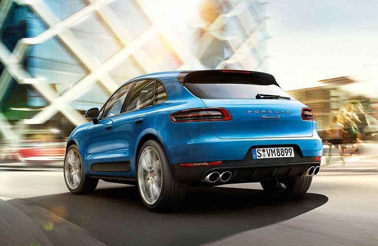 2019 Porsche Macan exterior back fascia and drivers side with blurred town