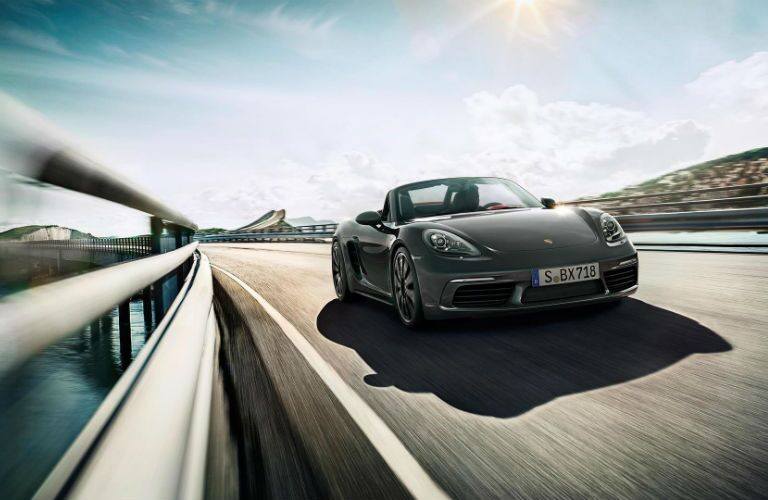 2019 Porsche 718 Boxster driving across a bridge