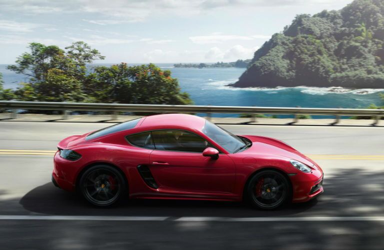 2019 Porsche 718 Cayman GTS driving on a bridge by water