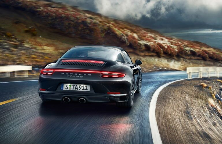 2019 Porsche 911 Targa 4S driving along a mountain