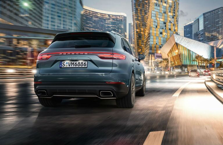 2019 Porsche Cayenne rear end view as it drives in a city
