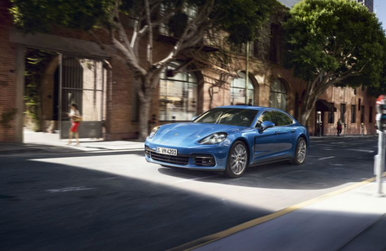 2019 Porsche Panamera driving on a one-way road