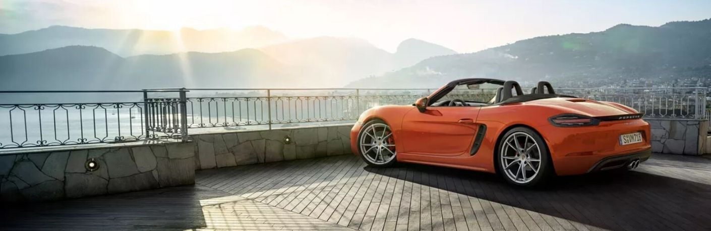Exterior view of an orange 2020 Porsche 718 Boxster