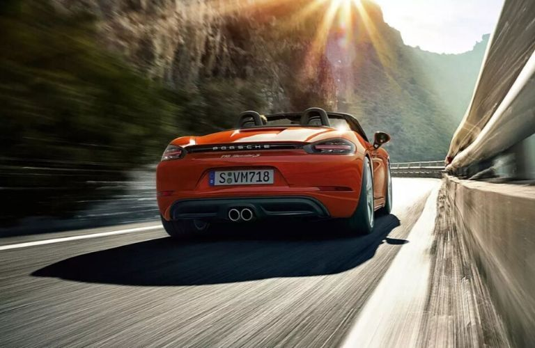 Exterior view of the rear of an orange 2020 Porsche 718 Boxster