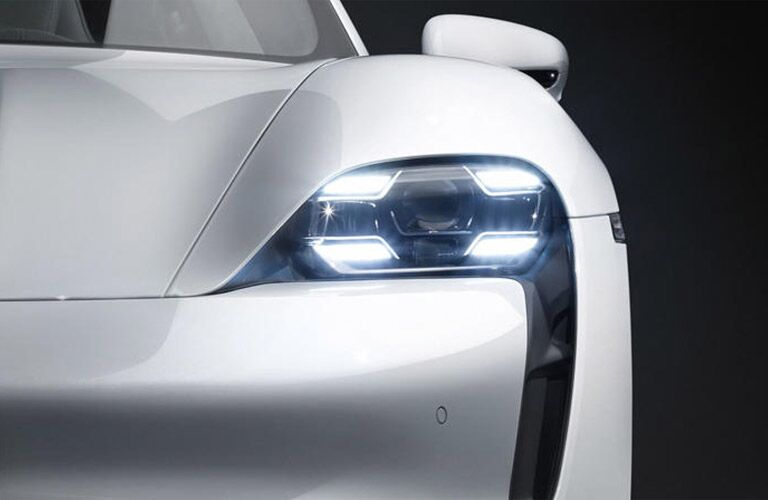 2020 Porsche Taycan close up of driver side front fascia headlight