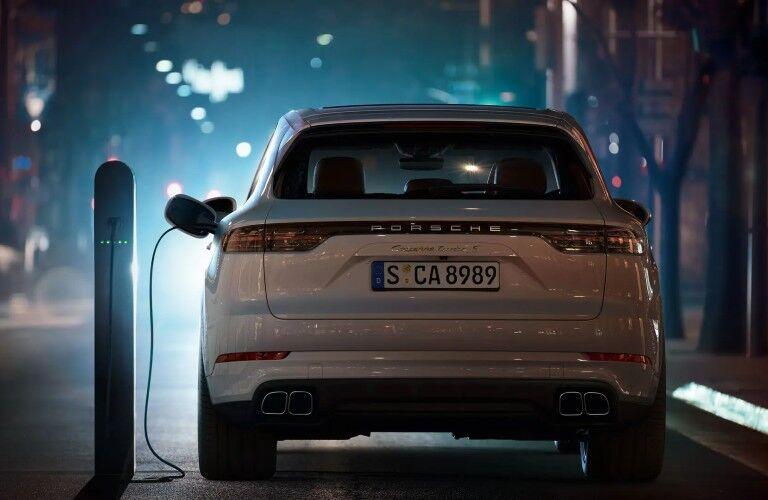 rear view of white 2020 Porsche Cayenne E-Hybrid charging