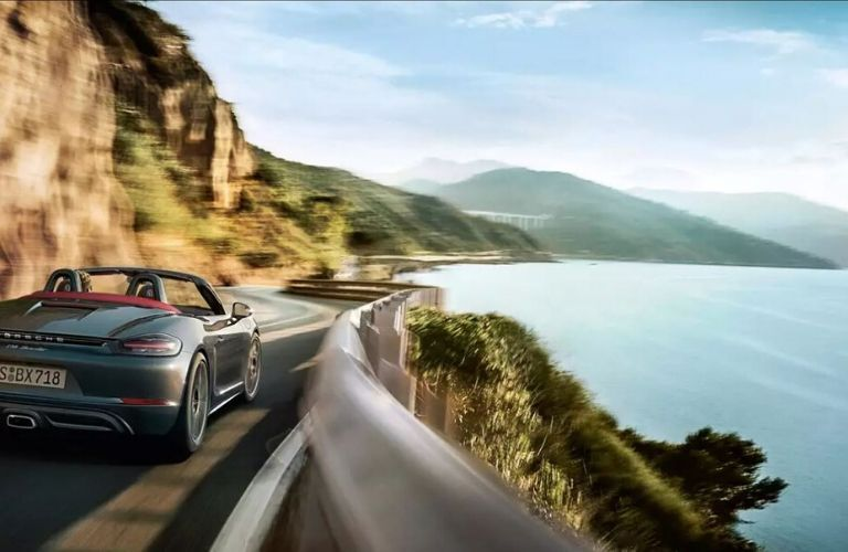 2020 Porsche Boxster driving near water