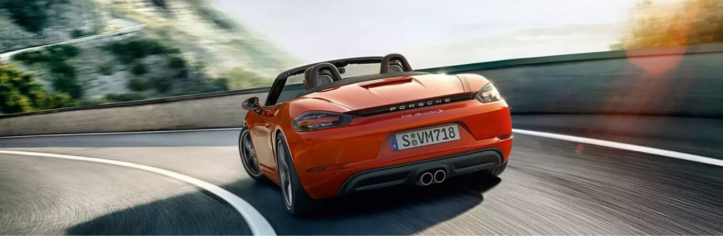 2020 Porsche Boxster driving rear view
