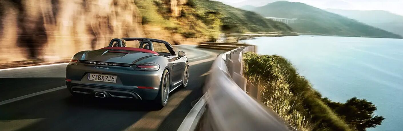 2021 Porsche 718 Boxster driving away