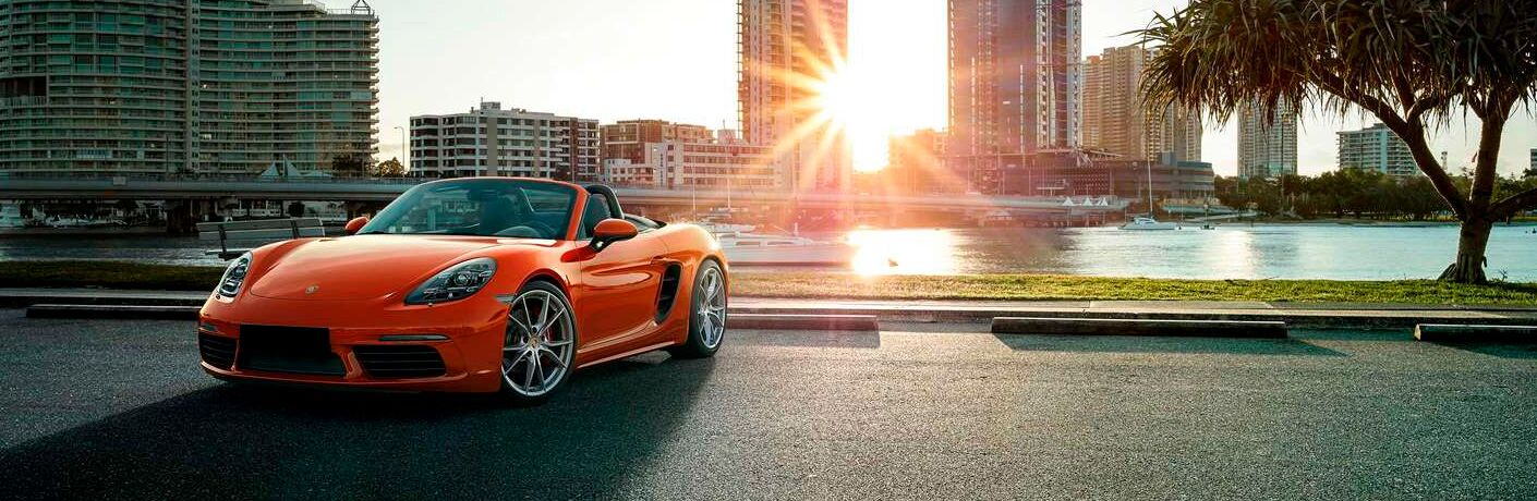 2021 Porsche 718 Cayman with big city buildings in the background