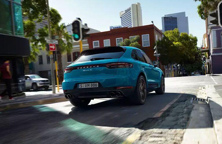 2021 Porsche Macan driving away