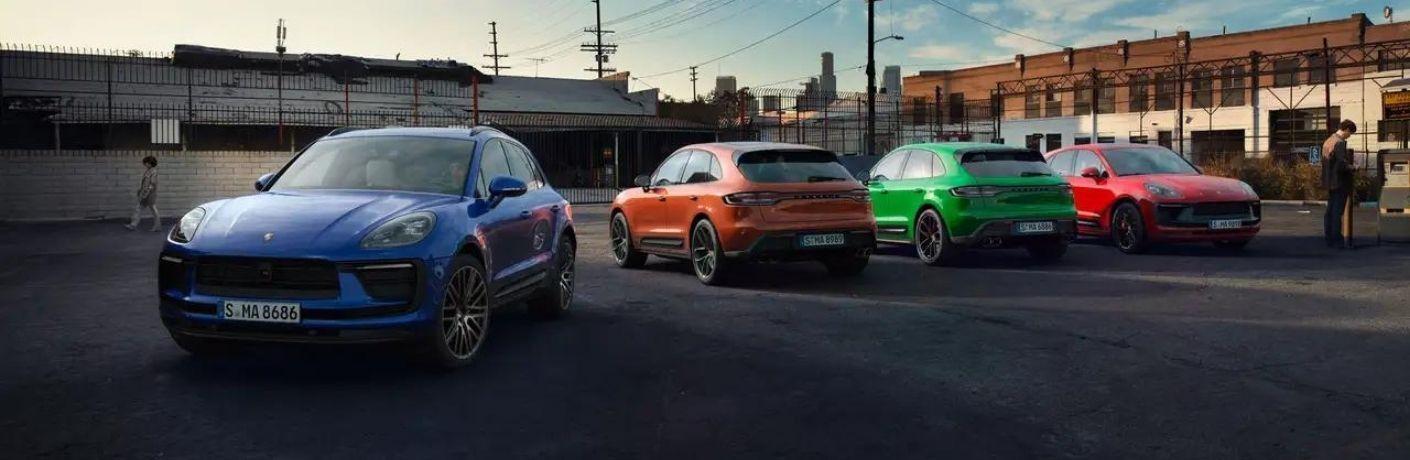 Four 2022 Porsche Macan in a parking lot