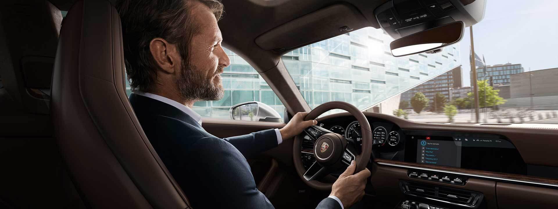 A man sitting in a Porsche in Newark, DE