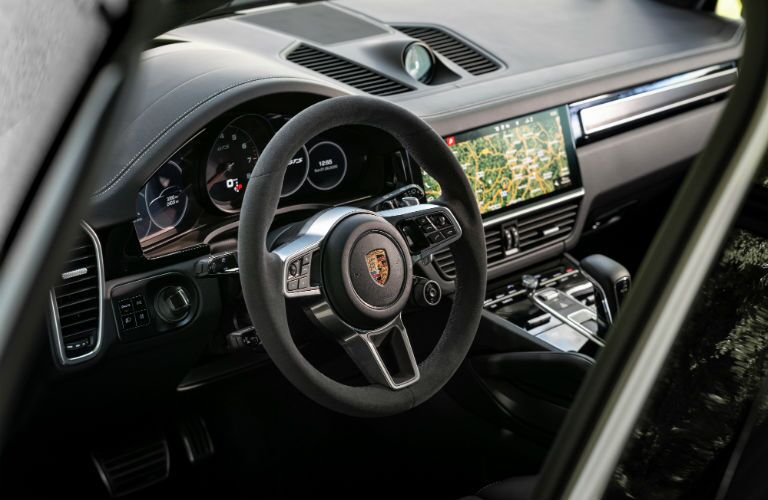 A photo of the driver's cockpit in the 2021 Porsche Cayenne.