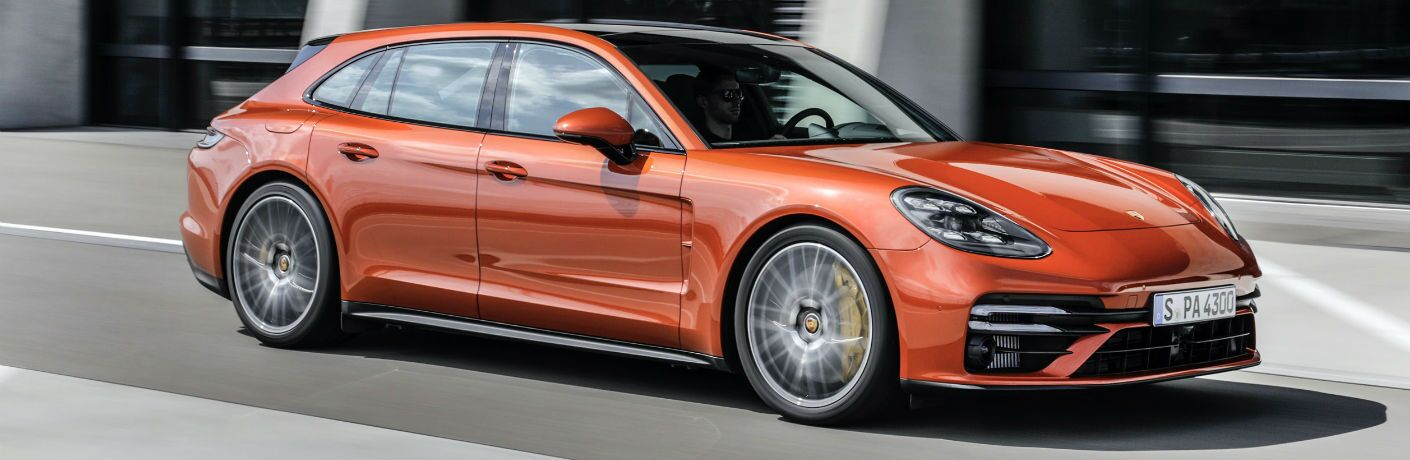 A right profile photo of the 2021 Porsche Panamera in motion on the road.