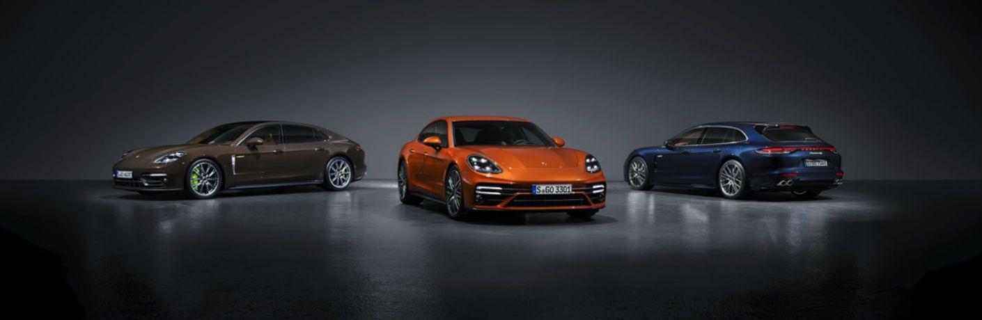 A photo of three 2021 Porsche Panamera models.