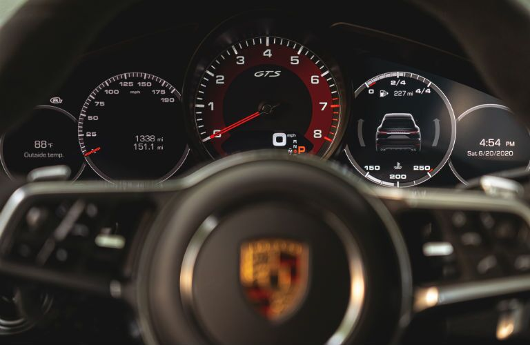 A photo of the gauge cluster behind the steering wheel in the 2021 Porsche Cayenne.