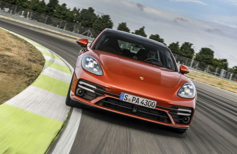A head-on photo of the 2021 Porsche Panamera on a race track.