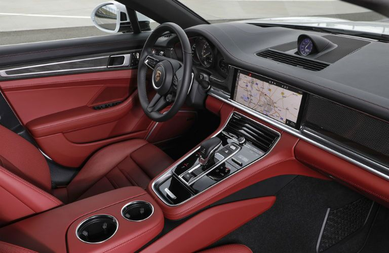 A photo of the dashboard and driver's cockpit in the 2021 Porsche Panamera.