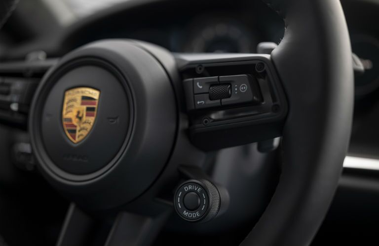 A photo of the controls attached to the steering wheel used by the 2021 Porsche 911 Turbo S.