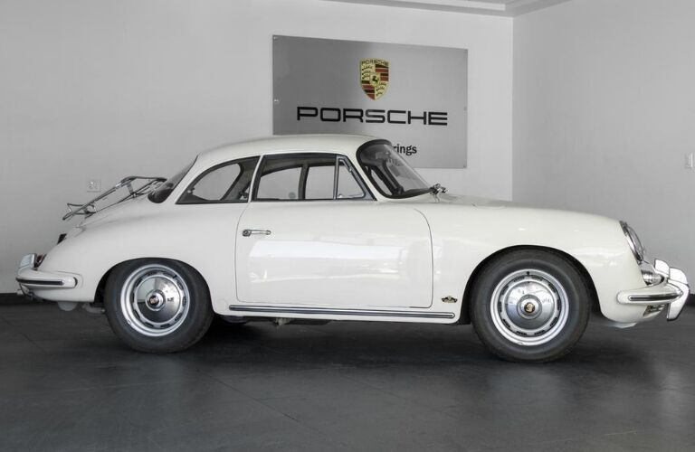1962 Porsche 356 B Notchback viewed from side on Porsche of Colorado Springs showroom floor