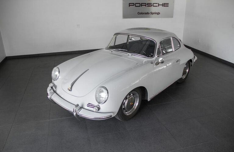 Front and Side Exterior of 1964 Porsche 356 C in Porsche of Colorado Springs Showroom