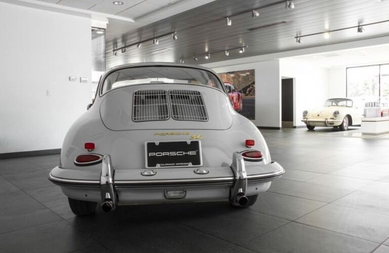 Grey 1964 Porsche 356 C Rear Exterior in Porsche of Colorado Springs Showroom