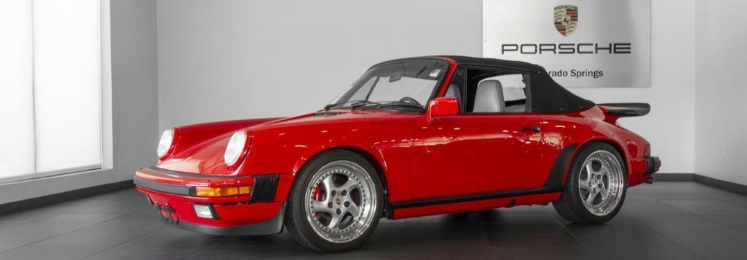 1988 Porsche 911 Carrera Cabriolet viewed from side on showroom floor
