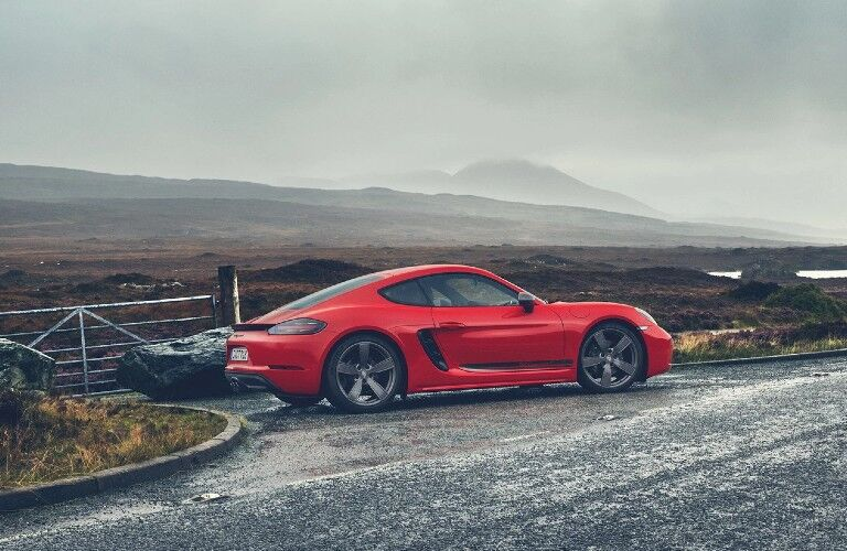 Profile of red 2020 Porsche 718 Cayman