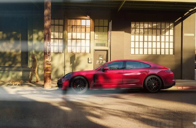 Side view of red 2020 Porsche Panamera GTS
