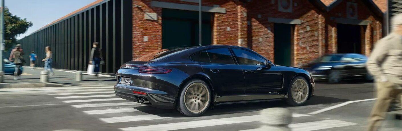Grey 2020 Porsche Panamera driving