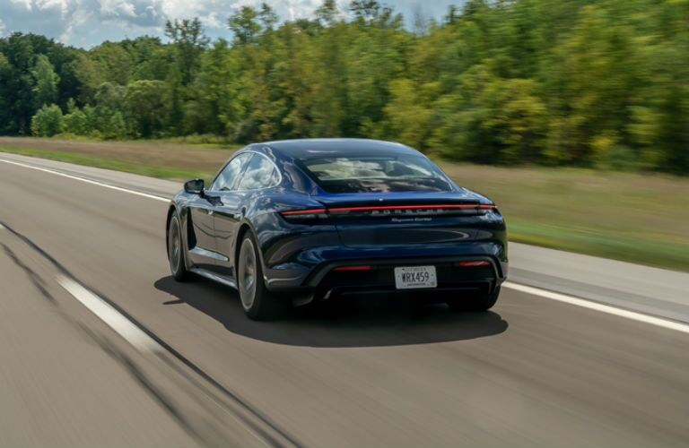 Side rear view of blue 2020 Porsche Taycan Turbo