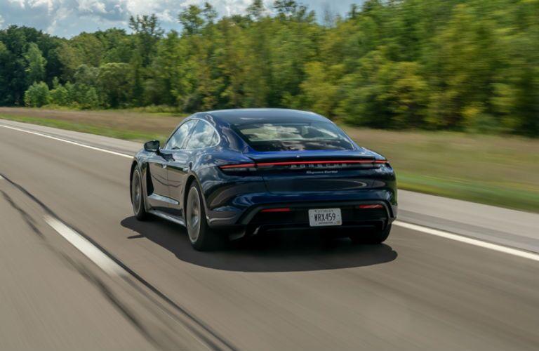 Side rear view of blue 2020 Porsche Taycan Turbo