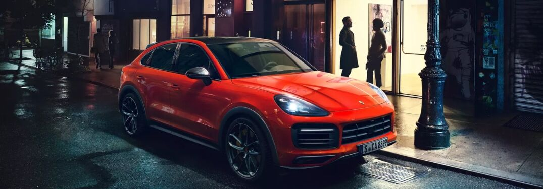2020 Porsche Cayenne Coupe on city street at night