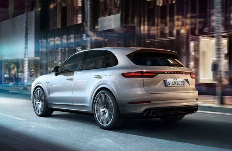 Silver 2020 Porsche Cayenne Rear Exterior on City Street at Night