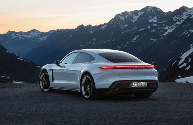 White 2020 Porsche Taycan Rear Exterior in Front of Mountains