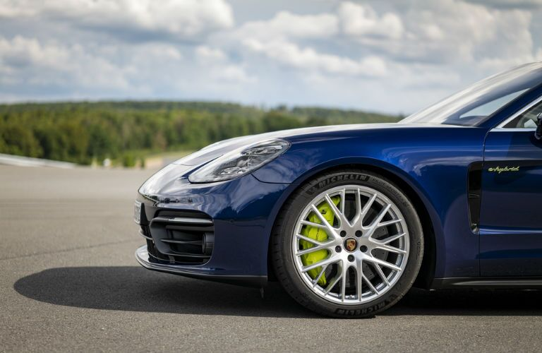 Closeup of wheel on blue 2021 Porsche Panamera