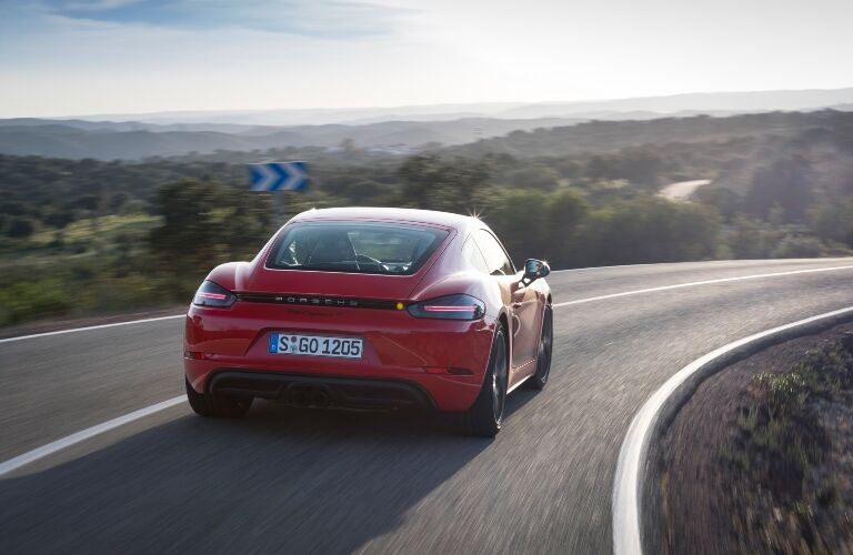 2020 Porsche 718 Boxster driving down highway away from camera