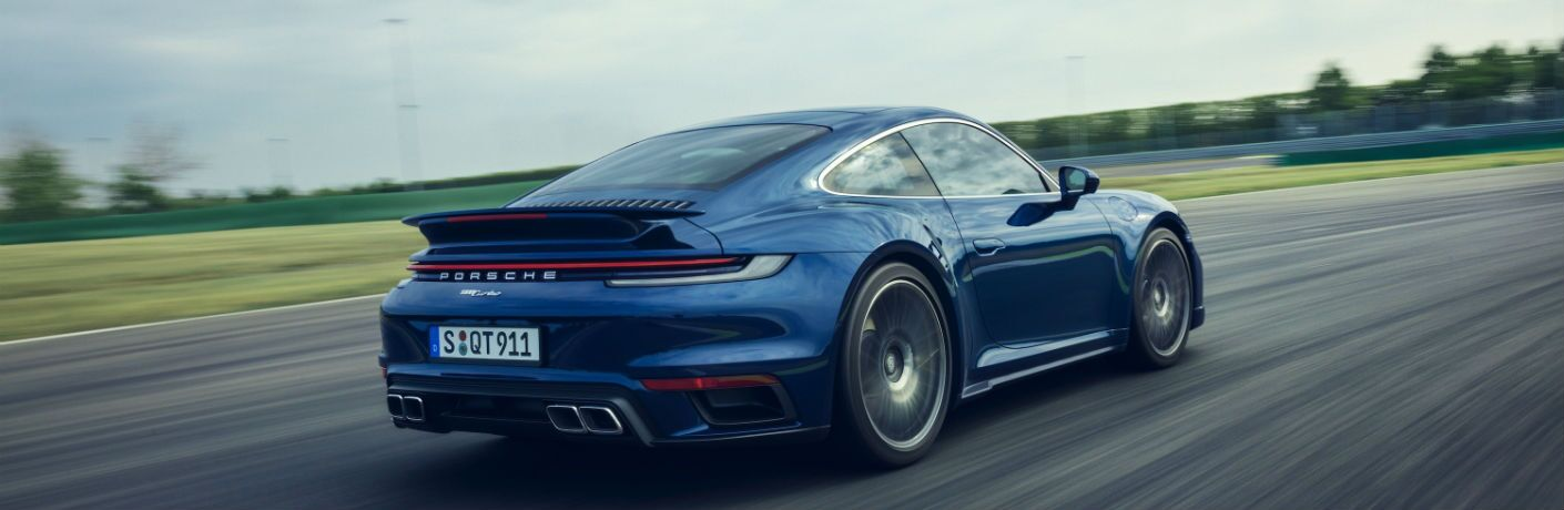 A photo of the 2021 Porsche 911 on a race track.