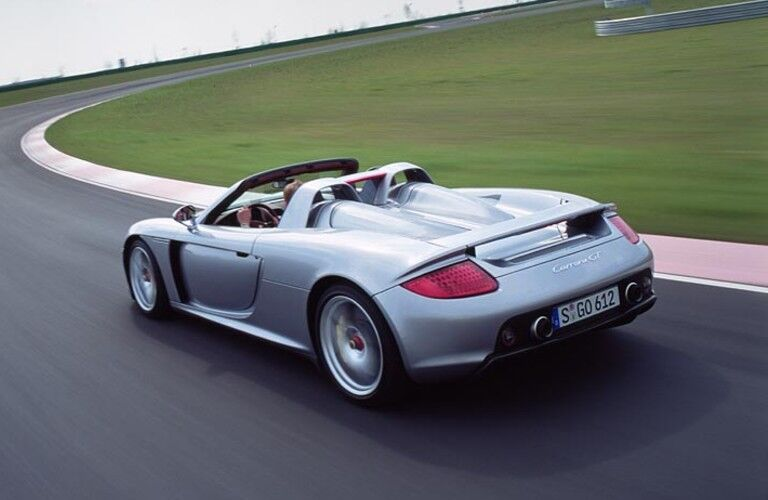 Rear view of silver Porsche Carrera GT