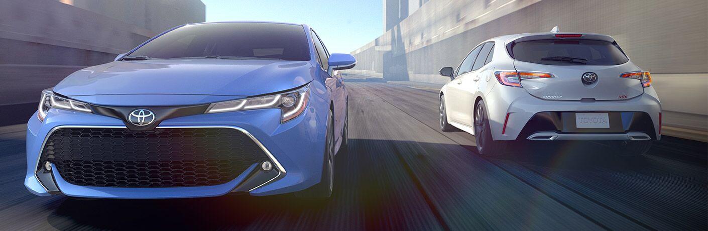 two 2019 corolla hatchbacks driving