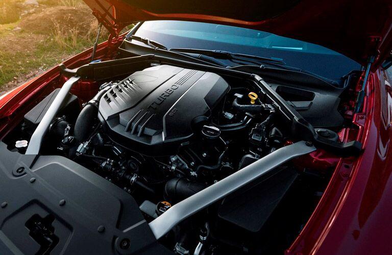 Hood of 2018 Kia Stinger raised to reveal turbocharged engine