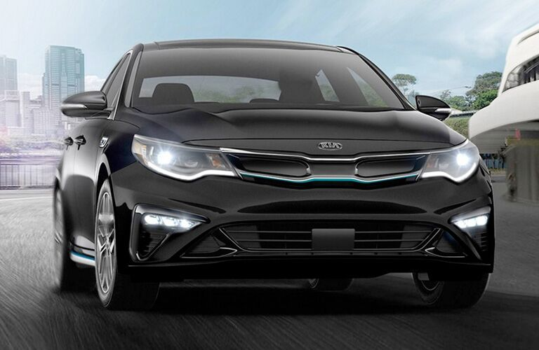 2020 Kia Optima exterior front fascia passenger side in empty lot and blue sky