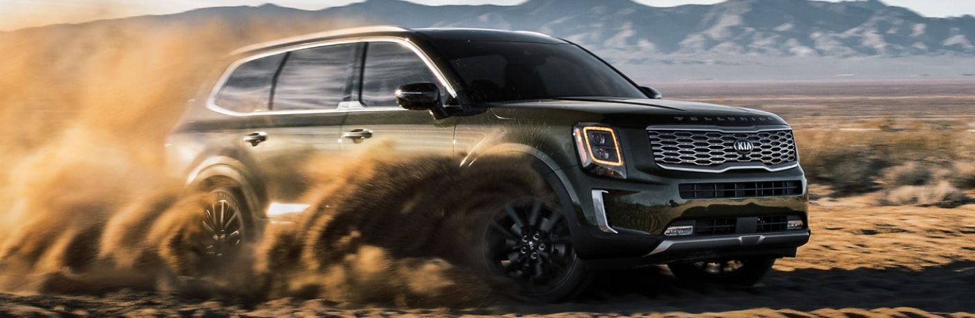 2020 Kia Telluride exterior front fascia passenger side kicking up dirt