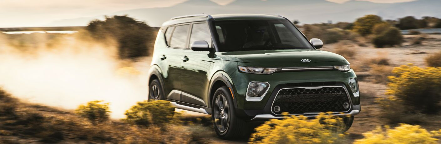 A front right photo of the 2020 Kia Soul driving through the desert.