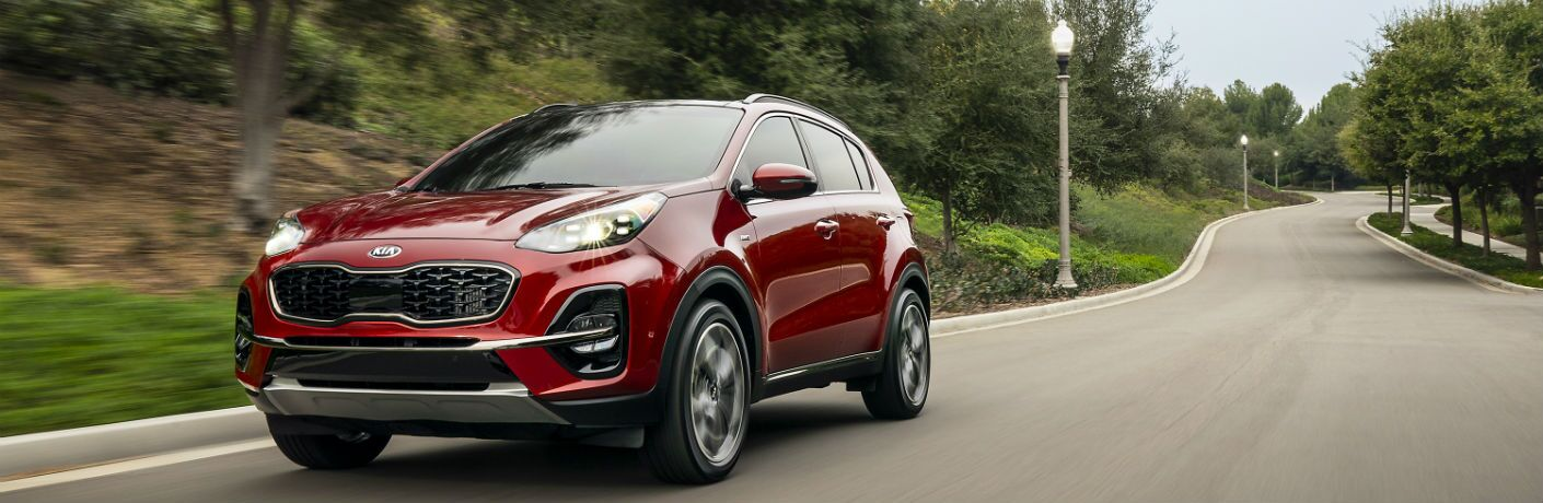 A front left quarter photo of the 2020 Kia Sportage on the road.