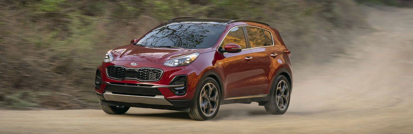 A photo of the 2020 Kia Sportage in motion on the dirt road.