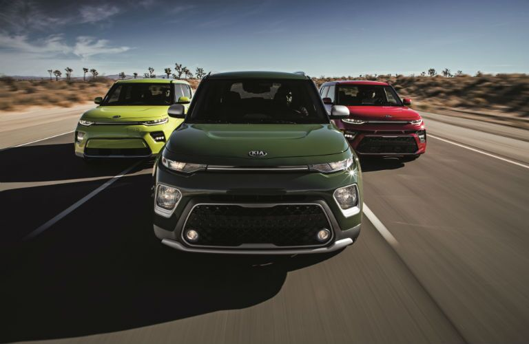 A photo of thee models of the 2020 Kia Soul on the road.
